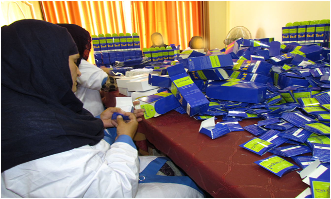Women packing ASMO products