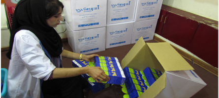 Image of a woman packing ASMO products