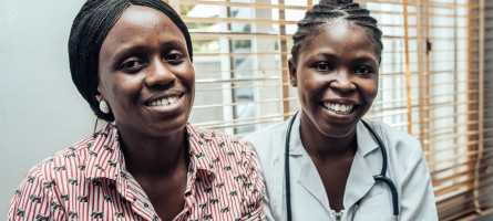 A woman health worker and her patient